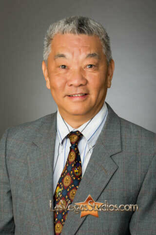 traditional mens-business-headshot of Asian executive